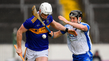 Michael Breen of Tipperary and Conor Gleeson of Waterford. Photo by Ramsey Cardy/Sportsfile