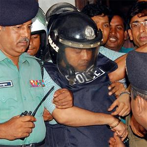 Mohammed Sohel Rana, owner of the Rana Plaza, is escorted outside of court after his hearing in Dhaka