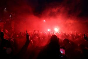 Liverpool fans celebrate outside Anfield. PA Photo. Picture date: Wednesday July 22, 2020. See PA story SOCCER Liverpool. Photo credit should read: Martin Rickett/PA Wire.