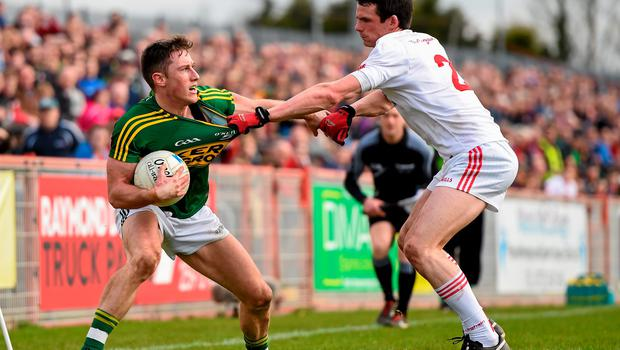 Kerry's Jonathan Lyne in action against Aidan McCrory of Tyrone