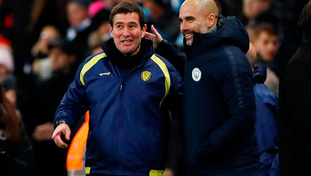 Manchester City manager Pep Guardiola and Nigel Clough after the match