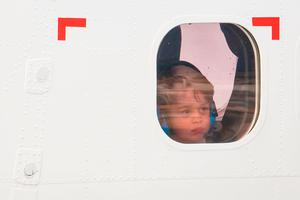 Prince George looks out of the window of a float plane as he departs from Victoria Harbour Airport in Victoria, Canada, on the eighth day of the Royal Tour to Canada.
