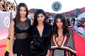 (L-R) Model Kendall Jenner, TV personalities Kylie Jenner, and Kim Kardashian attend the 2014 MTV Video Music Awards at The Forum on August 24, 2014 in Inglewood, California.  (Photo by Jeff Kravitz/FilmMagic)