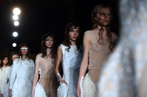 Models present creations from the Simone Rocha collection during the 2015 Spring / Summer London Fashion Week