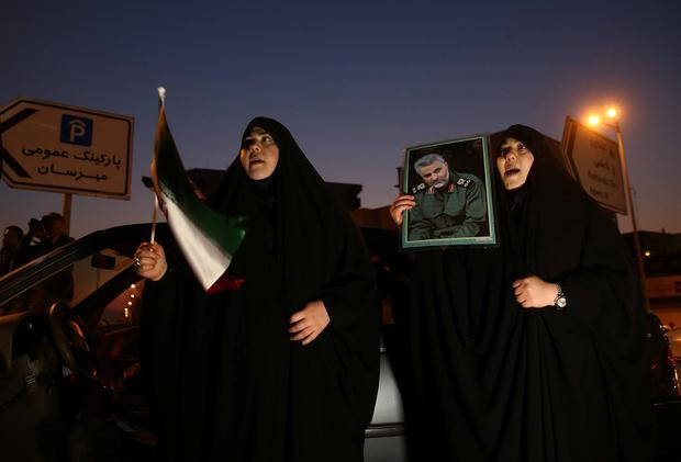 A woman holds a picture of late Iranian Major-General Qassem Soleimani, as they celebrate in the street after Iran launched missiles at U.S.-led forces in Iraq, in Tehran, Iran, January 8, 2020. Nazanin Tabatabaee/WANA (West Asia News Agency) via REUTERS ATTENTION EDITORS - THIS IMAGE HAS BEEN SUPPLIED BY A THIRD PARTY