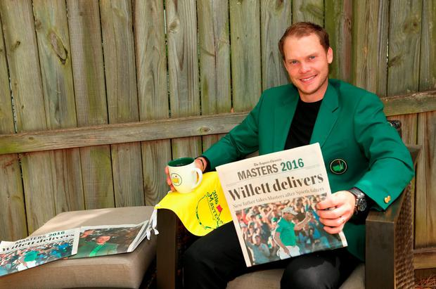 The 2016 Masters champion Danny Willett reads the headlines in his green jacket at his rented house in Augusta, Georgia yesterday. Photo: Andrew Redington/Getty