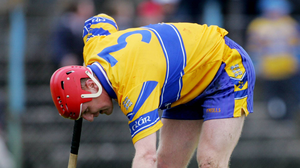 Brian Lohan checks on David Fitzgerald during the Allianz NHL game against Cork at Cusack Park in 2005. Photo: Sportsfile