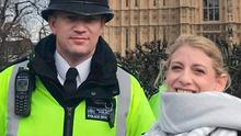 Staci R. Martin pictured posing for a photo next to Police Officer Keith Palmer outside the Houses of Parliament in London shortly before he was killed in an attack in Westminster while on duty at Parliament when he was stabbed to death. (Claire Thorogood via the AP)