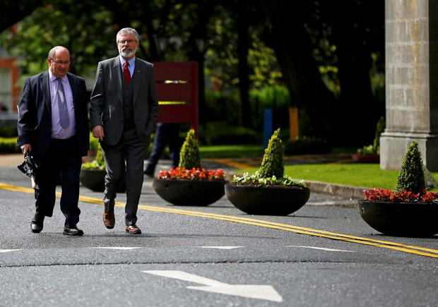 Sinn Fein president Gerry Adams (R) arrives at the National University of Ireland in Galway, Ireland May 19, 2015. Britain's Prince Charles is to meet Gerry Adams in Ireland on Tuesday, the first time the leader of the former political wing of the Irish Republican Army (IRA) has met a senior member of the royal family, his Sinn Fein party said.   REUTERS/Darren Staples