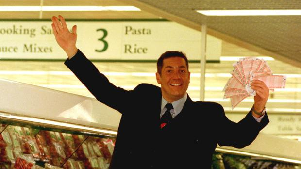 Dale Winton doing a 'Supermarket Sweep' in Brent Cross, London, to promote the midweek National Lottery. The presenter has died at the age of 62, his agent has said (Tony Harris/PA)