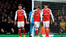 Arsenal's Alex Oxlade-Chamberlain, Nacho Monreal and Granit Xhaka look dejected after Bayern Munich's Arjen Robben scores their second goal