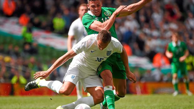 Phil Jagielka is stopped in his tracks by Jon Walters
