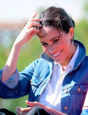 Meghan, Duchess of Sussex smiles as she visits Waves for Change, an NGO, at Monwabisi Beach, with Prince Harry, Duke of Sussex on September 24, 2019 in Cape Town, South Africa