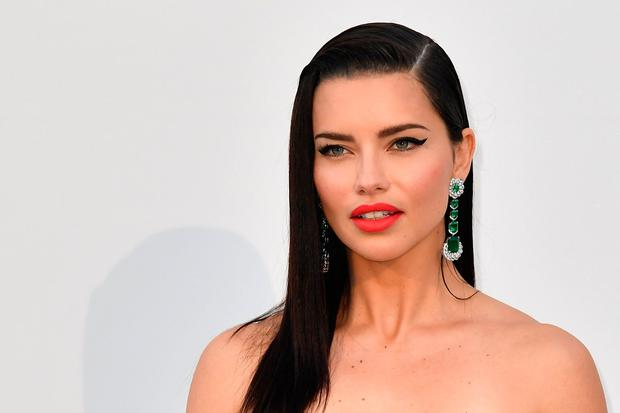 Brazilian model Adriana Lima poses as she arrives on May 23, 2019 at the amfAR 26th Annual Cinema Against AIDS gala at the Hotel du Cap-Eden-Roc in Cap d'Antibes, southern France, on the sidelines of the 72nd Cannes Film Festival. (Photo by Alberto PIZZOLI / AFP)