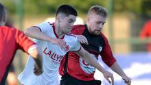 Sean Bailey of Redeemer and Aidan Curtin, Rock Celtic, compete for possession. Picture: Ken Finegan