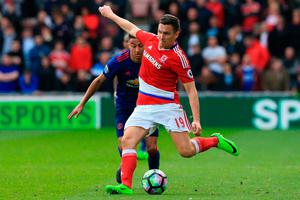 Middlesbrough's English midfielder Stewart Downing crosses the ball. Photo: Getty Images