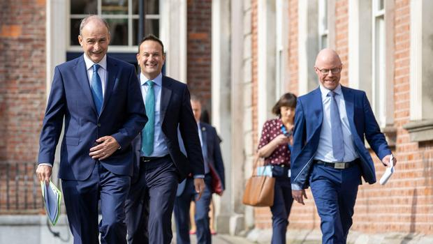 Taoiseach Micheal Martin, Tanaiste Leo Varadkar and             Minister for Health, Stephen Donnelly, arriving at the             unveiling of the Irish Government's blueprint for living             with Covid-19 in Dublin. Photo: Julien Behal/PA