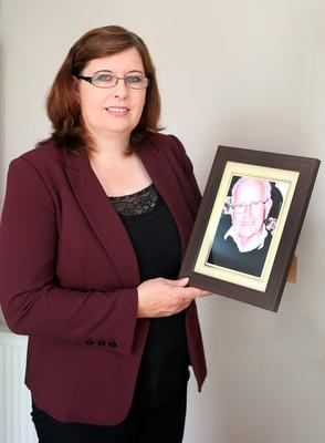 Elaine Leavey with a photo of her late father, Maurice, who she cared for with her mother June and night nurse Kathy Kileen. Photo: Damien Eagers