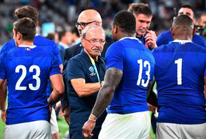 France's head coach Jacques Brunel (C) congratulates  his players after the  Japan 2019 Rugby World Cup Pool C match between France and Argentina at the Tokyo Stadium in Tokyo on September 21, 2019. (Photo by FRANCK FIFE / AFP)FRANCK FIFE/AFP/Getty Images