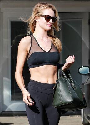 Rosie Huntington-Whiteley shows of her impressive abs as she leaves the gym in West Hollywood