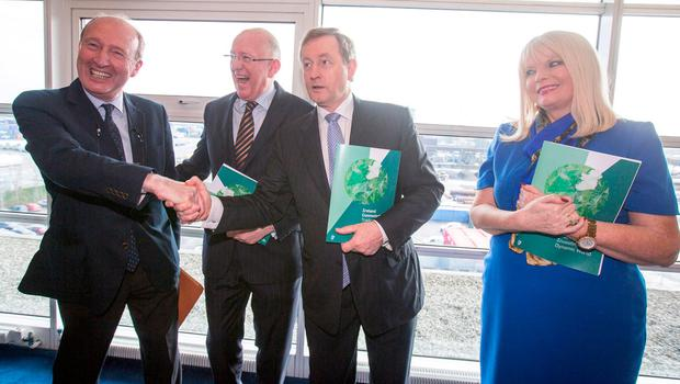 Taoiseach Enda Kenny who launched the government's new trade strategy, Ireland Connected: Trading and Investing in a Dynamic World at the Dublin Port Company with Minister for Foreign Affairs and Trade, Charlie Flanagan, Minister for Jobs, Enterprise and Innovation, Mary Mitchell O'Connor and Minister for Transport, Tourism and Sport, Shane Ross. Photo: Mark Condren