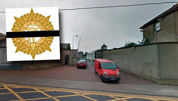 Sarsfield barracks and inset many soldiers are posting an image of the defence forces logo with a black band through it.