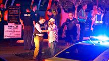 Police talk to a man outside the Emanuel AME Church following a shooting Wednesday, June 17, 2015, in Charleston, S.C. (Wade Spees/The Post And Courier via AP)