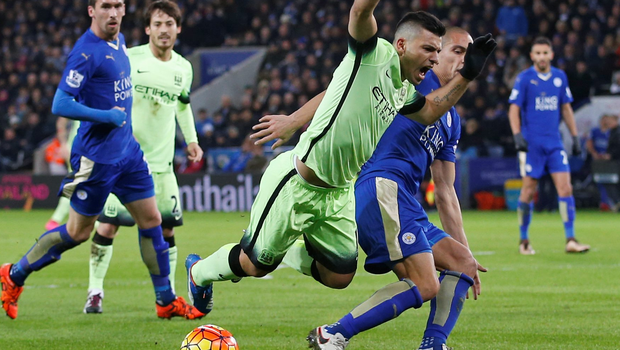 Manchester City's Sergio Aguero is challenged in the penalty area by Gokhan Inler of Leicester City during the Premier League match at The King Power Stadium last night