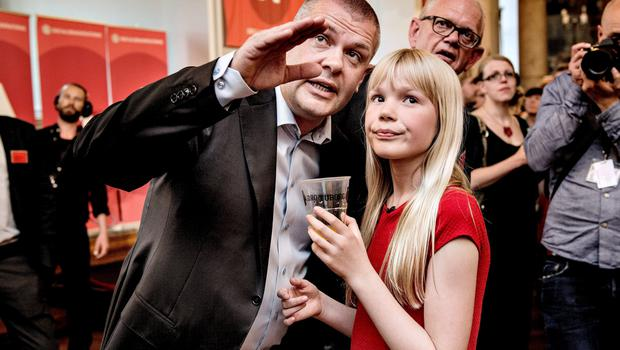 Minister of Finance Bjarne Corydon talks to his daugher during Socialists Party's election party in the Common Hall at Christiansborg on election day, June 18, 2015. REUTERS/Bax Lindhardt/Scanpix Denmark