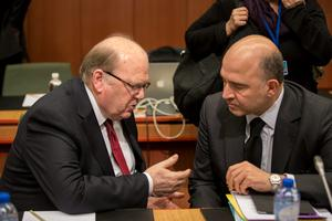 9th March 2015 - Brussels, Belgium - Pictured at the Eurogroup meeting of EU euro zone finance ministers were, left to right, Finance Minister Michael Noonan with Pierre Moscovici, European Commissioner for Economic and Financial Affairs, Taxation and Customs. Photo by Peter Cavanagh Photography [Must Credit]