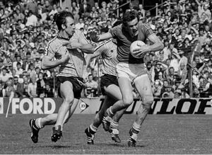 Dublin's Mick Kennedy challenges Colm O'Rourke of Meath during the 1983 Leinster Senior Football Championship quarter-final in Croke Park. Inset: Kennedy in the colours of his club St Margarets. Main photo: Ray McManus/Sportsfile