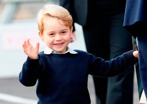 Prince George of Cambridge waves as he leaves from Victoria Harbour to board a sea-plane on the final day of their Royal Tour of Canada