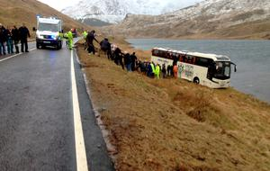 """An accident on the A83 near the Rest And Be Thankful in Argyll, which left five people seriously injured and 25 who are described as """"walking wounded"""" after a coach carrying tourists crashed off a popular route. Photo: Stuart Herd/PA Wire"""
