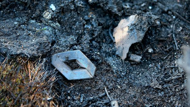A Renault badge from a Renault Megan Van pictured at Beechlawn Grove  where a van which was burnt out after a Hit and run on Hazelwood Drive, Kilmore, Coolock.Picture: Frank Mc Grath