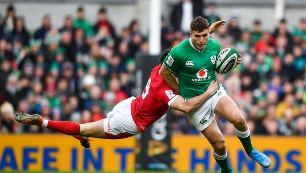 Jordan Larmour of Ireland is tackled by Tomos Williams of Wales during the Six Nations match at Aviva Stadium in Dublin. Photo by David Fitzgerald/Sportsfile