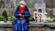 Front page fame: Pauline Goodwin and her dog at the gardens in Royal Hospital Kilmainham in late March. Photo: Steve Humphreys