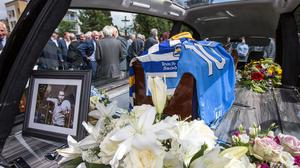 Templeogue Synge Street jersey and the Dublin Number 10 jersey are placed on the coffin of Anton O'Toole at the Church of St Paul of the Cross, Mount Argus in Dublin. Pic:Mark Condren 20.5.2019