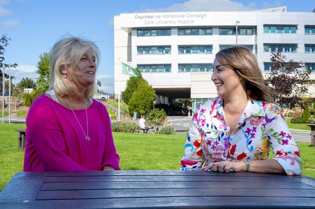 Cancer survivors and friends Sylvia McHenry, left, and Miriam Healy, who raised almost a tenth of the €550,000 needed to secure the Ion Torrent Sequencer for Cork University Hospital, through Cork Pink Week fundraising events. (Colm Lougheed/PA)
