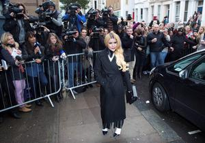 "British singer Paloma Faith arrives for the recording of the Band Aid 30 charity single in west London November 15, 2014. Singers came together to record a new version of the Band Aid charity song to raise money to combat Ebola in Africa. The single, ""Do They Know It's Christmas?"", was first recorded 30 years ago after musician and philanthropist Bob Geldof inspired a host of stars to come together under the Band Aid name to help those affected by famine in Ethiopia. REUTERS/Neil Hall (BRITAIN - Tags: ENTERTAINMENT SOCIETY HEALTH DISASTER)"