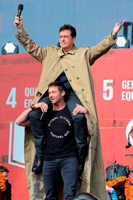 Hosts Stephen Colbert (top) and Hugh Jackman speak on stage at the 2015 Global Citizen Festival to end extreme poverty by 2030 in Central Park on September 26, 2015 in New York City.  (Photo by Theo Wargo/Getty Images for Global Citizen)