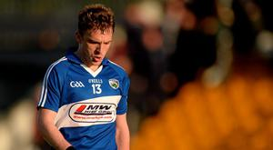Ross Munnelly, Laois, leaves the field after the game
