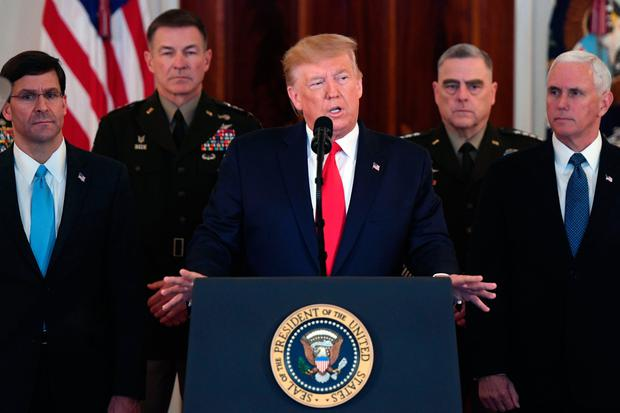 US President Donald Trump(C) speaks about the situation with Iran in the Grand Foyer of the White House in Washington, DC, January 8, 2020. (Photo by SAUL LOEB / AFP) (Photo by SAUL LOEB/AFP via Getty Images)