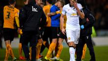 Michael Carrick of Manchester United reacts as Cambridge United players celebrate