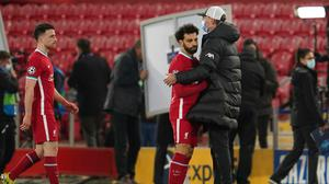Liverpool's manager Jurgen Klopp, right, greets Liverpool's Mohamed Salah at the end of the Champions League quarter final second leg game against Real Madrid