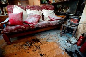 17 Oct 2014; General view of damage from petrol bomb in living room of the Halligan home in Ardmore Park, Waterford. Picture: Caroline Quinn
