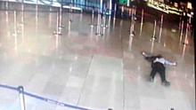 An airport CCTV screen images shows a man on the ground inside Orly Sud terminal following a shooting incident at Orly Airport near Paris, France March 18, 2017.   REUTERS/CCTV via Twitter