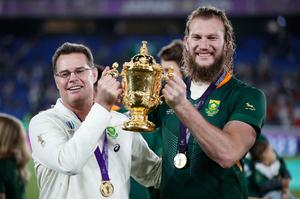 Rassie Erasmus and Munster's new recruit RG Snyman pose with the Webb Ellis Cup