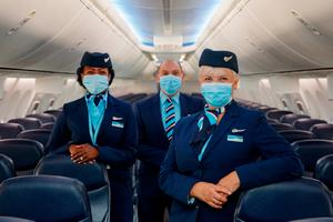 Flight attendants in their PPE waiting for passengers to board a flight in the UK. The Taoiseach ruled out easing of quarantine rules for British tourists coming here. Photo: Ben Queenborough/PinPep/TUI/PA Wire