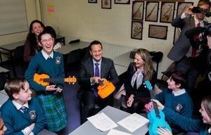 Mood music: Leo Varadkar and candidate Emer Currie join a ukulele class at Castleknock Community College, Dublin. PhOTO: GARETH CHANEY/COLLINS
