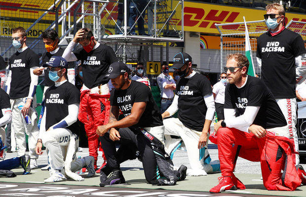 Mercedes' Lewis Hamilton, Ferrari's Sebastian Vettel and other drivers kneel on the grid wearing anti-racism t-shirts before yesterday's Austrian Grand Prix at the Red Bull Ring, Spielburg